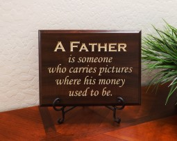 A father is someone who carries pictures where his money used to be.