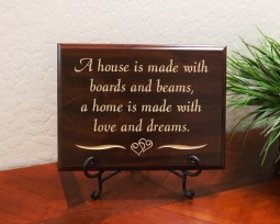 A house is made with boards and beams, a home is made with love and dreams.